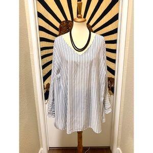 Beautiful stripped silky minimalist chic blouse